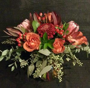 #3 Fall Mix. $75 Protea, deep orange roses, copper mums, seeded eucalyptus $75